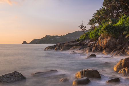 Kalim beach in Patong, Phuket, Thailand. Rock beach with strong wave, long exposure make it harmonic view. Capture this in the evening.