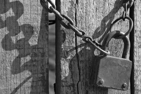 Old padlock with chain black and white photograph photo