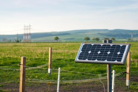 Solar energy panel with electric fence on a farm
