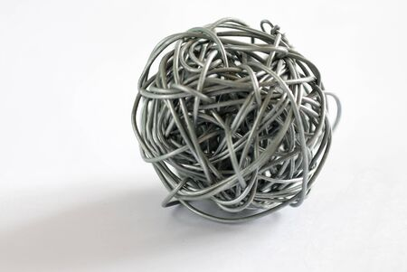 cable tangle: wire ball on white background - Depth of field close up photo Stock Photo