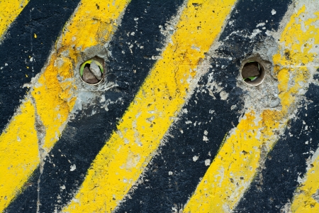 Grunge traffic signal yellow with black stripes - abstract texture photo