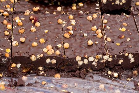 fairground: bulk hazelnut chocolate in a fairground stall, closeup photo Stock Photo
