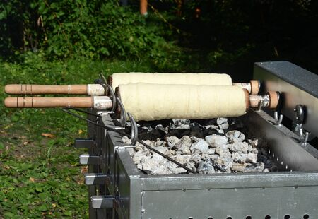 to spit: Traditional Transylvanian spit cake, coals baked sweets on modern baking equipment