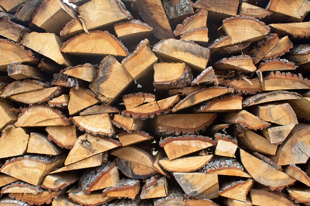 stacked up: The section of the firewood logs stacked up on top of each other in a pile Stock Photo