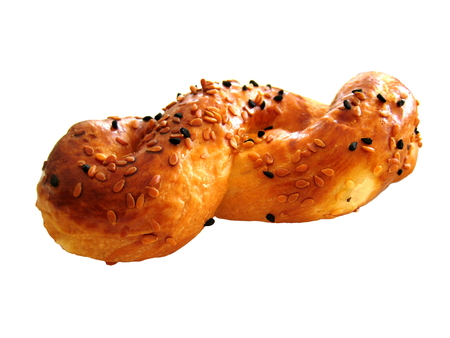 sesame seeds: the figure-eight bun with sesame seeds isolated Stock Photo