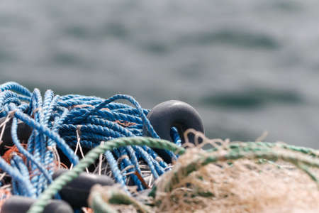 fishing floats: Fishing nets closeup. Background of fishing nets and floats. Stock Photo