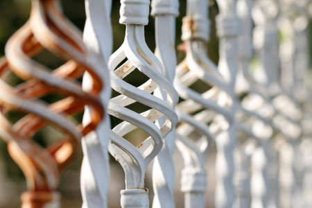 inserts: Brown white inserts forged fence close up. Detail Forge. Part of a wrought iron fence. Iron gate details.