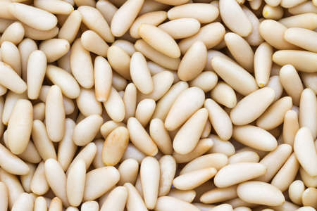 pine nuts: Close up view of texture of organic Pine Nuts. Pine nuts background. Stock Photo