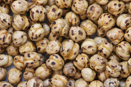 legume: Roasted chickpea background. Roasted chickpea legume high protein snack texture. Stock Photo