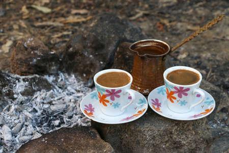 ember: Coffee cups. Serve coffee. Ember Turkish coffee. Roasted Turkish coffee. Traditional nubian coffee making. Coffee turk on the coal. Stock Photo