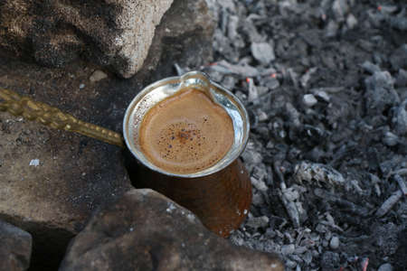 ember: Ember Turkish coffee. Roasted Turkish coffee. Traditional Nubian coffee making. Coffee turk on the coal.