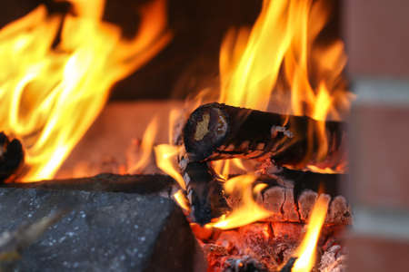 combustible: Close up shot of burning firewood in the fireplace in the house. Cosiness. Stock Photo
