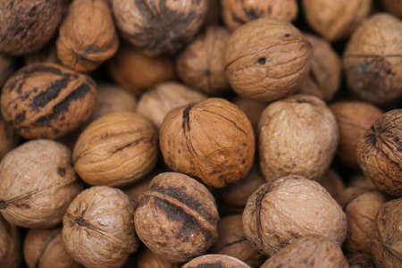 Pile of walnuts in shell. Close up. Stock Photo