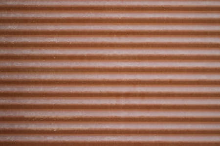rolling garage door: Brown metal roller shutter.
