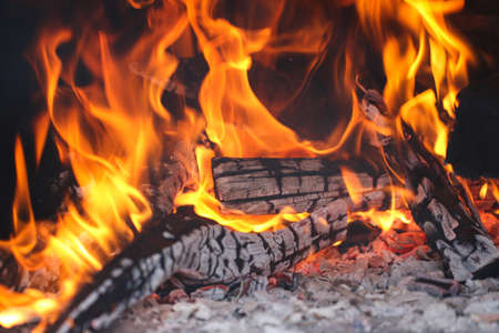scorching: Wood burning firewood in the traditional stone oven. Stock Photo