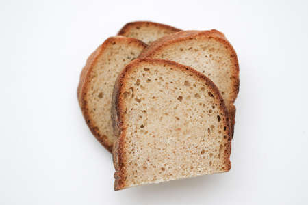 Sour yeast bread slices. Tradtional homemade bread on white background.