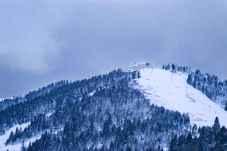 Uludag is the ancient Mysian Olympus and Bithynian Olympus, a mountain in Bursa Province, Turkey. Ski lifts durings bright winter day.