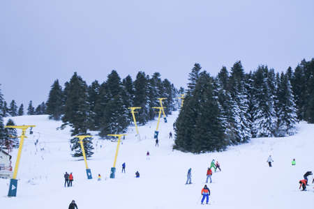 Skiing at the ski resort. Uludag is the ancient Mysian Olympus and Bithynian Olympus, a mountain in Bursa Province, Turkey. Ski lifts durings bright winter day.