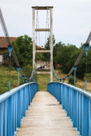 Close up of old blue bridge. Green background. Stock Photo