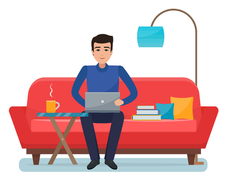 Freelancer man with computer on sofa at home.