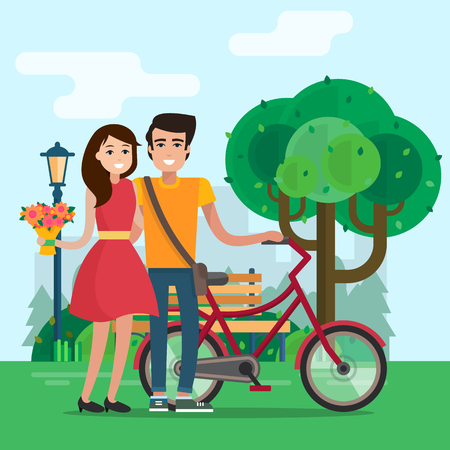 Man and woman on a date in park with flowers and bike.