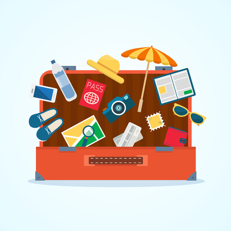 Open baggage with travel icons and objects.