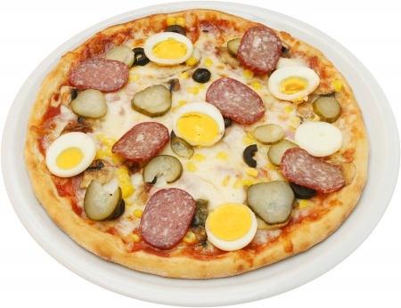 Pizza Capricciosa with cheese  tomatoes mushrooms egg flat sausage and ham  isolated photo