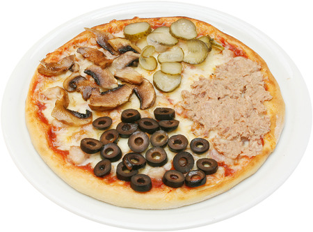 Pizza quattro stagioni with cheese tuna mushrooms and ham isolated photo