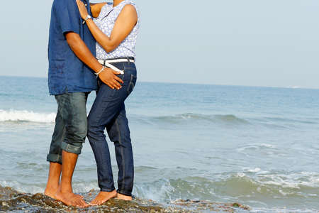 man and woman hugging by the beach