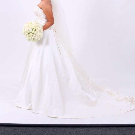 avantegarde: Beautiful elegant young bride in white long dress Stock Photo