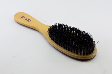 Elegant brush with handle, isolated on transparent or white background. Front view.