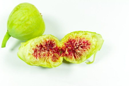 Ripe figs on a white background