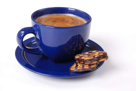 colombian food: Black coffee with chocolate cookie