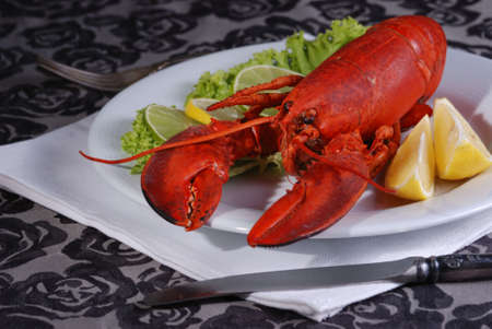 lobster tail: Seafood Dinnerþ Lobster  served on plater with lemon.
