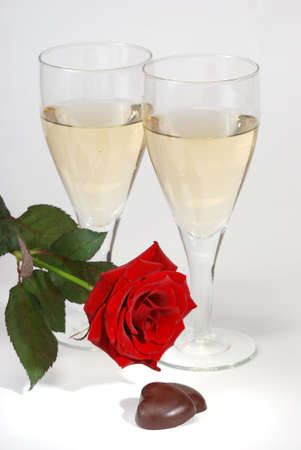 Champagne, rose  and chocolate over white background photo