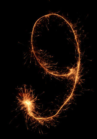 The Sparkler digit against a black background Stock Photo - 3757279