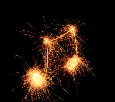Sparklers notes isolated on black background. Music symbol Stock Photo