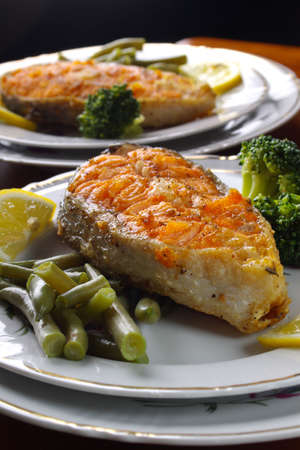 Roasted Salmon steaks  on white dishes