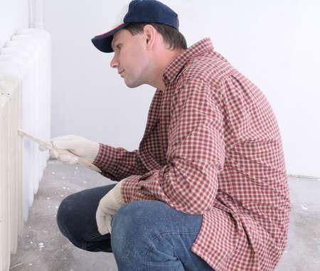 Man painting radiator Stock Photo - 3827385