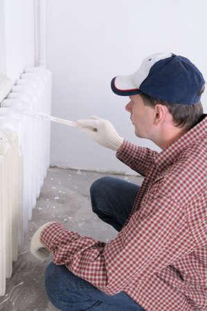 Man painting radiator Stock Photo - 3827423