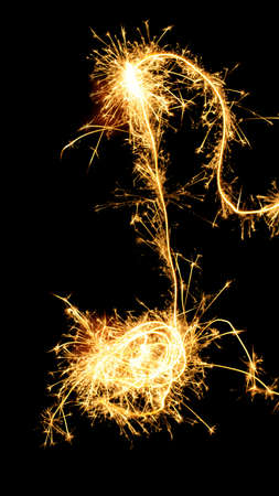Sparklers note isolated on black background. Music symbol photo