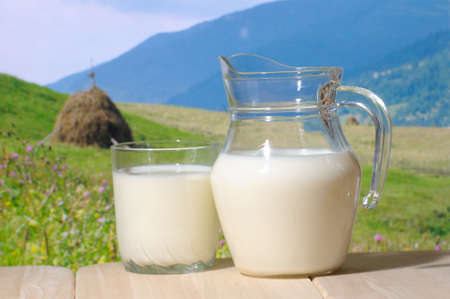Milk jug  against a mountains in background photo