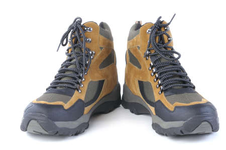 hillwalking: A pair of new hiking boots over a white background Stock Photo