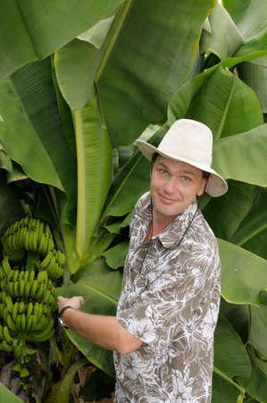 Tourist surprised on banana plantation photo