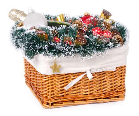Christmas gift basket on white background photo
