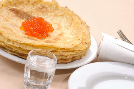 pancake with  red caviar photo
