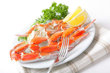 Crab legs with lemon and parsley Stock Photo