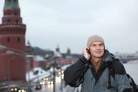 russian hat: Man talking on the phone