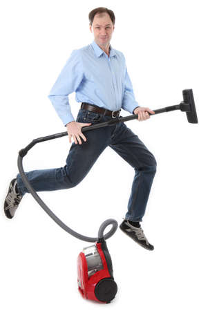 wondered: Man jumping with vacuum cleaner