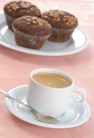 Cup of coffee and three chocolate chip muffins Stock Photo - 4490461